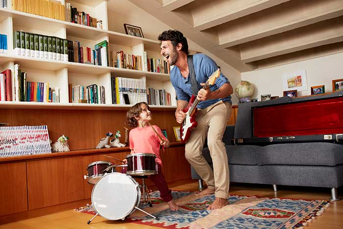 father jamming with little boy